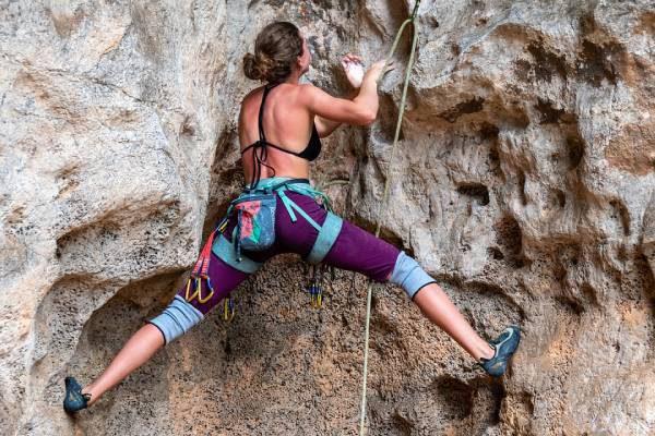 Woman climbing rockface outdoor activities
